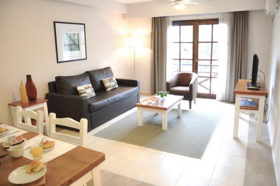 Green sea apart hotel pinamar 2 ambientes for Decoracion de living comedor integrados